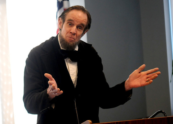 Amesbury: Steve Wood as Abraham Lincoln gives a talk at High tea on the President's Birthday presented by the Amesbury Carriage Museum at the Amesbury Senior Center Sunday afternoon. Jim Vaiknoras/staff photo