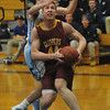Byfield: Newburyport's Dillion Guthro is fouled by Triton's Kevin Clark during their game at Triton . Jim Vaiknoras/staff photo