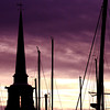 Newburyport: The sun sets behind boat masts and the Central Congregational Church in Newburyport Saturday afternoon. Jim Vaiknoras/staff photo