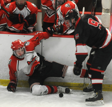 Newburyport: Amesbury's Jack Aponas is checked by  Marblehead's Liam Gillis during the Newburyport Bank 19 Annual Hockey Classic. Amesbury won the game in a shootout. Jim Vaiknoras/staff photo