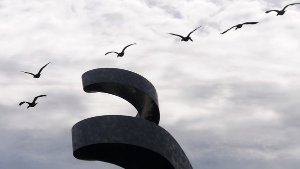 "Newburyport: A sextet of geese fly over Dale Roger sculture ""G-Swirl"" on the the Trail Rail Sunday afternoon. Jim Vaiknoras/staff photo"