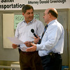 newburyport: Senator Bruce Tarr and Lucien Larcoix host a segment during the Opportunity Works 30th Annual Lend-A-Hand Auction at the Nock Middle School Saturday. Jim Vaiknoras/staff photo