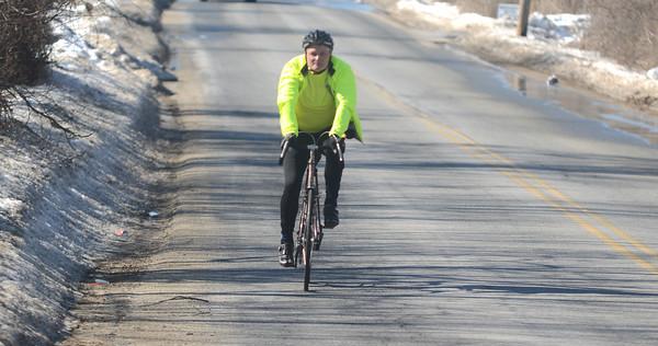 newburyport: Cyclist Keith Harris makes his way down Parker Street in Newburyport. Jim Vaiknoras/staff photo