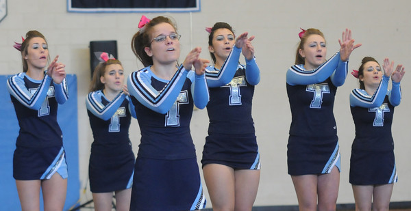 Byfield: The Triton cheering squad performs as the host team at the 2014 Viking Winter Invitational Sunday afternoon. Jim Vaiknoras