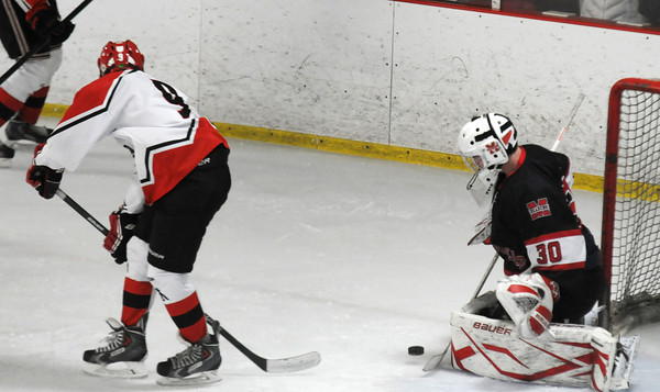 Newburyport: Amesbury's Brendan Foley's back handed shot is stopped by  Marblehead Harrison Young during the Newburyport Bank 19 Annual Hockey Classic. Amesbury won the game in a shootout. Jim Vaiknoras/staff photo