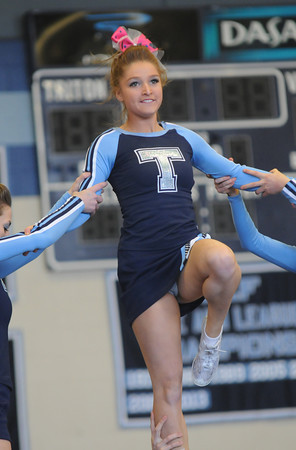 Byfield: Teagan Newhall of Triton performs with the Triton cheering squad  at the 2014 Viking Winter Invitational at Triton Sunday afternoon. Jim Vaiknoras