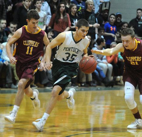 West Newbury:Pentucket's Adam Chory out races Newburyport's Mike Shay  and Jake Berger during their game at Pentucket Friday night. Jim VAiknoras/staff photo