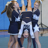 Byfield: Caroline Murry of Gloucester is flipped as she performs with the Hamilton Wenham cheering squad at the 2014 Viking Winter Invitational at Triton Sunday afternoon. Jim Vaiknoras