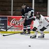 Newburyport: Triton's Joe Schickling clears the puck past Newburyport's Tyler Therrien during the Newburyport Bank 19 Annual Hockey Classic. Amesbury won the game in a shootout. Jim Vaiknoras/staff photo