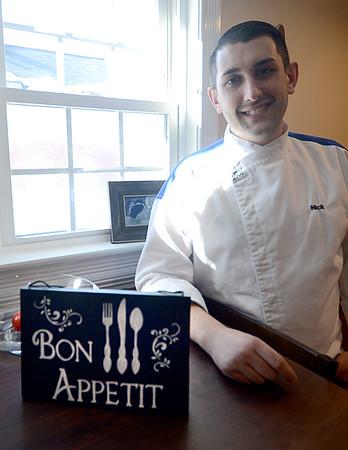 JIM VAIKNORAS/Staff photo Hell's Kitchen contestant Nick Peters in his Newburyport kitchen.