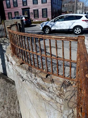 BRYAN EATON/Staff Photo. Rusty handrails and crumbling concrete on the Washington Street bridge.