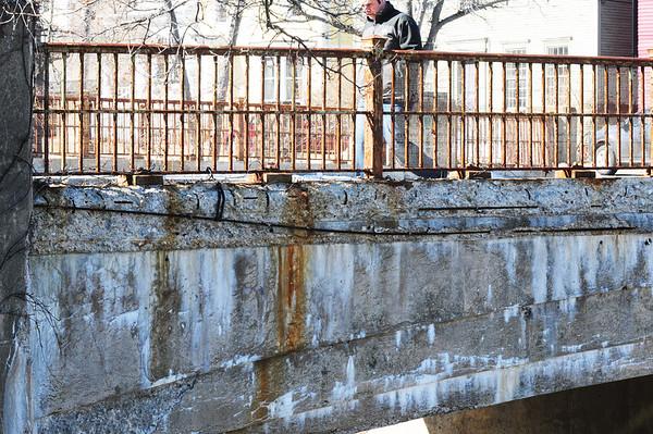 BRYAN EATON/Staff Photo. Another view of the exposed rebar on the Washington Street bridge.