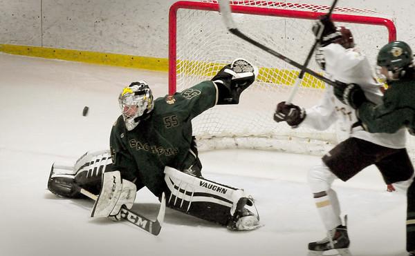 BRYAN EATON/Staff Photo. Pentucket goalie Cam Ludwig deflects a shot by Newburyport.