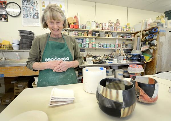 JIM VAIKNORTAS/Staff photo Ceramics artist Irina Okula with some of her pieces.