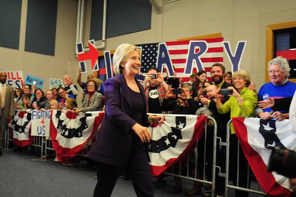 JIM VAIKNORAS/Staff photo Presidential candidate Hillary Clinton walks in to an event at Winnacunett High School in Hampton.