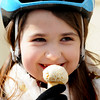 JIM VAIKNORAS/Staff photo Ava Roy-Arsenault, 8, enjoys a vanilla ice cream on Inn Street while out on a bike ride Sunday with her mom.