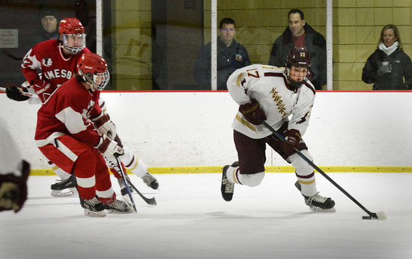 BRYAN EATON/Staff Photo. Newburyport's Scott Webster looks for an open teammate with Amesbury players moving in.