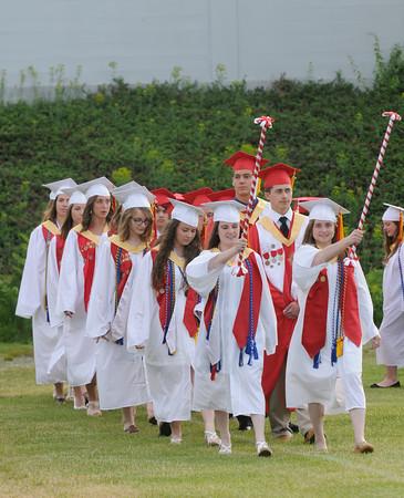 JIM VAIKNORAS/Staff photo Amesbury graduates march in to Landry Stadium Friday night.