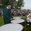 JIM VAIKNORAS/Staff photo Senior Max Walsh plays timpani with the band one last time at Pentucket graduation Saturday.