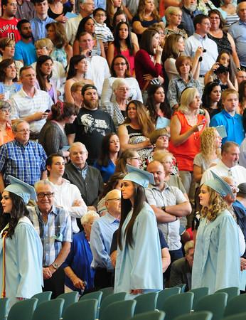 BRYAN EATON/Staff Photo. Triton seniors enter the fieldhouse at the beginning of graduation ceremonies.