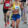 JIM VAIKNORAS/Staff photo Woman's winner Katie Misuraca of  the Lions Club Yankee Homecoming 10 mile race in Newburyport.