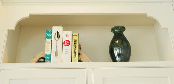 BRYAN EATON/ Staff Photo. A cutout spot above the cupboards for cookbooks.
