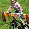 BRYAN EATON/ Staff Photo. Thomas Duratti, 4, of Newburyport got first place in the boys category at the Kids Day in the Park Carriage and Bike Parade with his Newburyport spirit-themed bicycle.