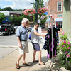 BRYAN EATON/ Staff Photo. John and Marcia Melnyk check out clothes at Parke Place Boutique in downtown Amesbury before heading to Ovedia Chocolates. The Rowley couple like to explore towns in the area and come to Amesbury for shopping and dining occasionally.