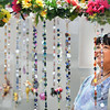 BRYAN EATON/ Staff Photo. Joanne Vien of Merrimac checks out Fairy Bead Sun Catchers made by Rita Scalera of Hampton, N.H. at the Market Square Craft Fair.