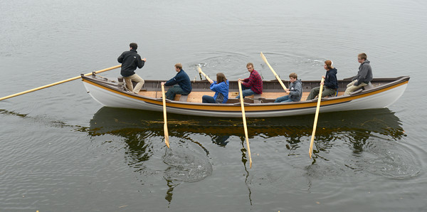 Amsbury: Seven apprentices paddle the whale boat they helped build at teh Lowell Boat shop in Amesbury Sunday. Jim Vaiknoras/staff photo