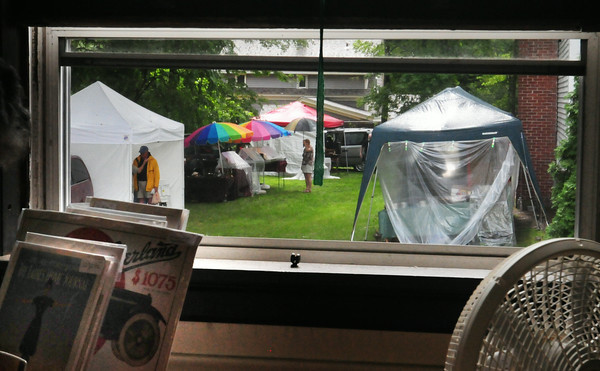BRYAN EATON/Staff Photo. The crowd was sparse outside the Belleville Church for the 50th Annual Antique Show and Sale at the beginning of the day as the rain was falling.