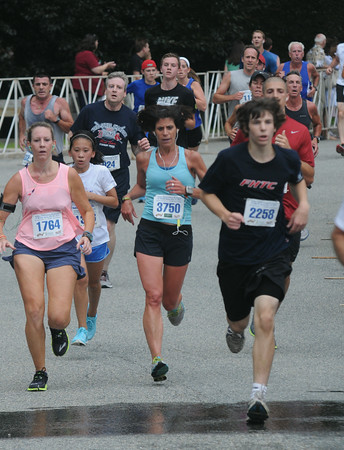 JIM VAIKNORAS/Staff photo Runners finish the Lions Club Yankee Homecoming 5k in Newburyport.