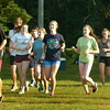 BRYAN EATON/ Staff Photo. Teens head out on a run at Maudslay State Park after hearing from Boston Marathon runner Ruben Sanca.