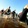 JIM VAIKNORAS/Staff photo Swimmer enter Lake Gardner in Amesbury at the start of the 2014 Dam Triathlon Saturday.