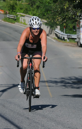 JIM VAIKNORAS/Staff photo #5 finishes up teh cycling portion of the Dam Triathlon at Lake Gardner in Amesbury Saturday.