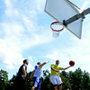 JIM VAIKNORAS/Staff photo Kyle Arseneau sglides in for 2 during The CarriageTown ThrowDown Saturday at Amesbury Park. Proceeds from the 3 on 3 basketball tournament went to the  Amesbury Educational Foundation.