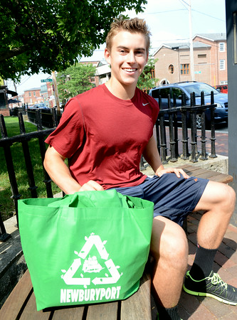 JIM VAIKNORAS/Staff photo  Winner of the Newburyport Recylable Bag design contest Conor McNamy, 17, with some of the bag at the Newburyport Library.