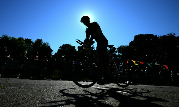 JIM VAIKNORAS/Staff photo A cyclist finishes up at Lake Gardner in Amesbury in the 2014 Dam Triathlon Saturday.
