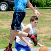 JIM VAIKNORAS/Staff photo Bobby Campbell up fakes Jack Fortin in the The CarriageTown ThrowDown Saturday at Amesbury Park. Proceeds from the 3 on 3 basketball tournament went to the  Amesbury Educational Foundation.