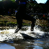 JIM VAIKNORAS/Staff photo A swimmer enters  Lake Gardner in Amesbury at the start of the 2014 Dam Triathlon Saturday.