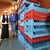BRYAN EATON/ Staff Photo. Salvation Army volunteers Mary Schmidt, left, and Mary Lou Roix with empty trays that held bread which came from Market Basket.