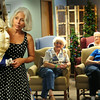 BRYAN EATON/ Staff Photo. Linda York-Robbins shows a papier mache bust of Queen Victoria to residents of the Salisbury Assisted Living Center on Wednesday. The art educator got the inspiration to make life-sized characters when she was a young girl with not a lot of toys to play with.