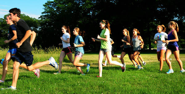 BRYAN EATON/ Staff Photo. Teens head out on a run with Ruben Sanca who ran the Boston Marathon.