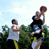 JIM VAIKNORAS/Staff photo Matt Talbot looks to pass around Curran O'Connor in the The CarriageTown ThrowDown Saturday at Amesbury Park. Proceeds from the 3 on 3 basketball tournament went to the  Amesbury Educational Foundation.