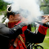 JIM VAIKNORAS/Staff photo Reinactor Robert Winer of Nashua and the 3rd Mass regiment fires his musket at Old Fashioned Sunday on the Mall in Newburyport Sunday.