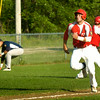 BRYAN EATON/ Staff Photo. Colton Fontaine heads for home plate as the Lawrence third baseman picks up a missed throw.