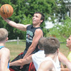 JIM VAIKNORAS/Staff photo Craig Bowen drive to the hoop in the The CarriageTown ThrowDown Saturday at Amesbury Park. Proceeds from the 3 on 3 basketball tournament went to the