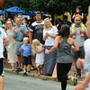 BRYAN EATON/Staff Photo. Runners in the 3-mile Yankee Homecoming Race get cheers from spectators in Newburyport's Market Square.