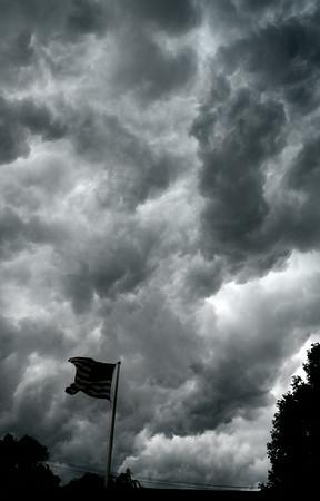 JIM VAIKNORAS/Staff photo Storm clouds over Liberty Street in Newburyport.
