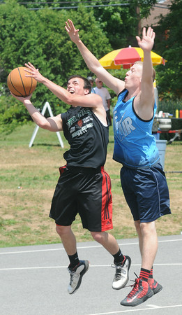 JIM VAIKNORAS/Staff photo Craig Bowen makes a move on Jack Fortin in the The CarriageTown ThrowDown Saturday at Amesbury Park. Proceeds from the 3 on 3 basketball tournament went to the  Amesbury Educational Foundation.